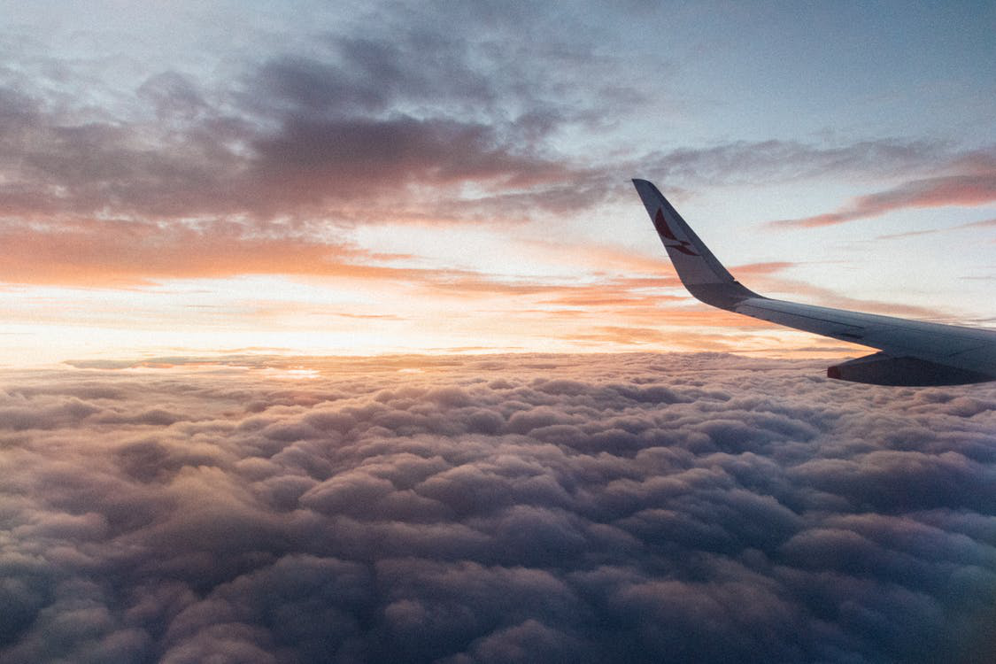 airplane wing view above clouds