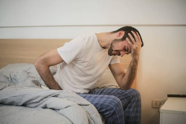 A man feeling sleepless because of anxiety