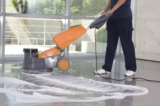 A professional janitorial service cleaning the office floors