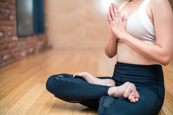 Woman wearing affordable activewear while doing yoga