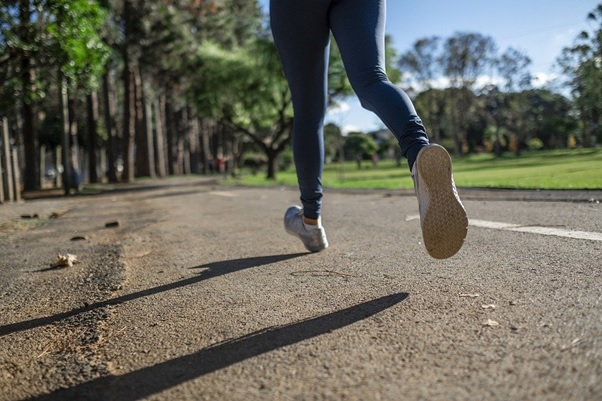 A woman wearing leggings while running
