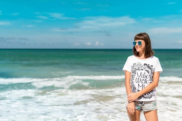 A woman posing on the beach.