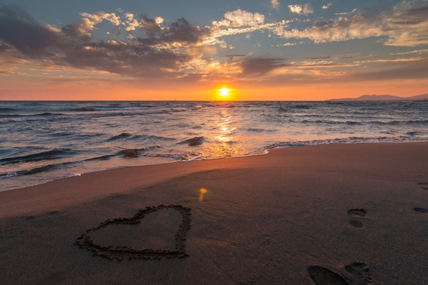 A heart made in the sand on the beach