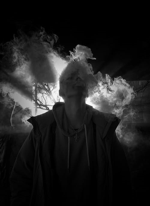 Man smoking through a glass pipe
