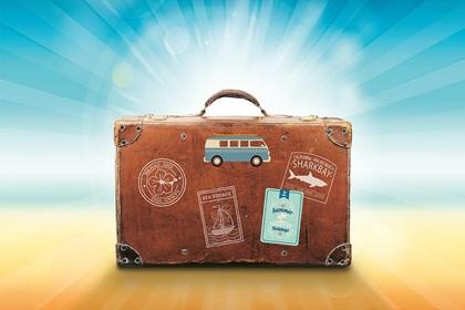 Beach-themed travel luggage.