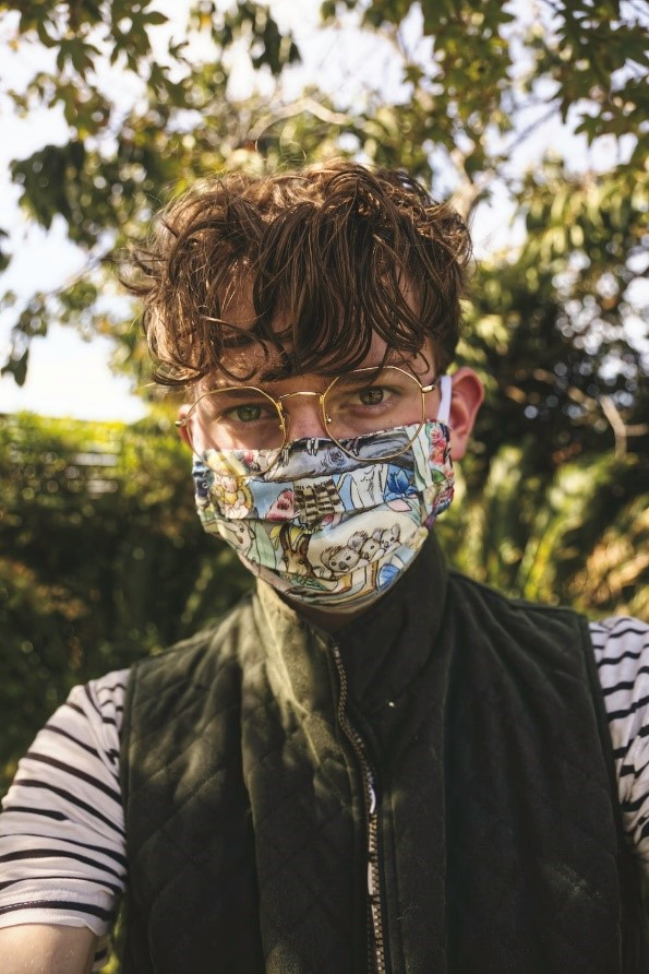 a boy with a colorful face mask