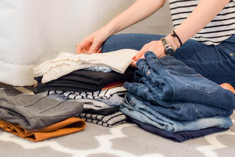 woman packs clothes