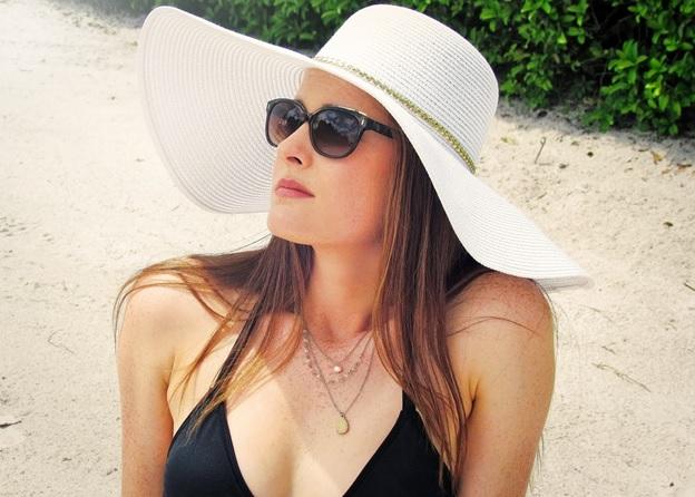 A woman wearing a straw hat