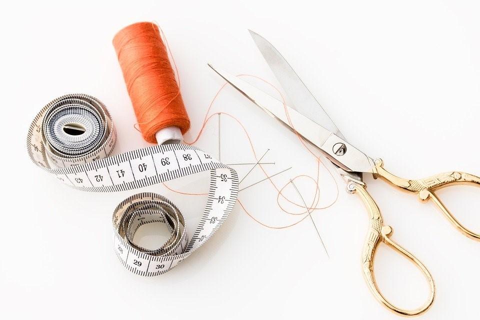 orange thread with scissors and tape measure