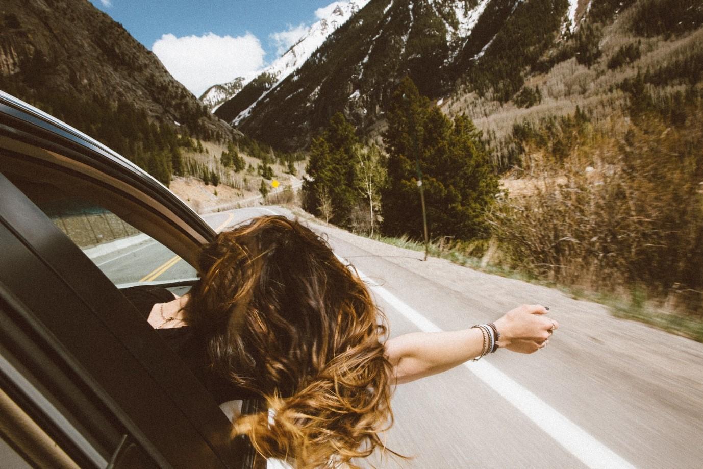 A person enjoying a road trip