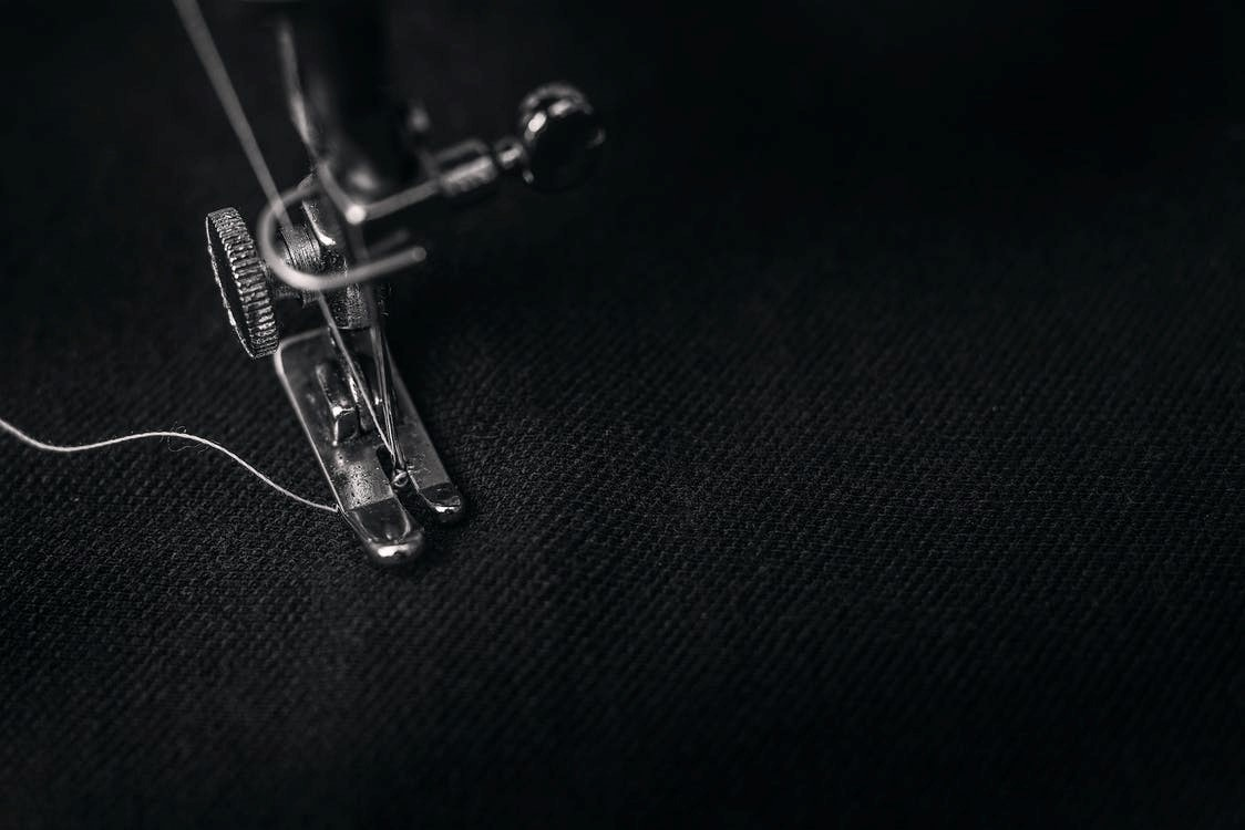 Sewing machine stitching clothes