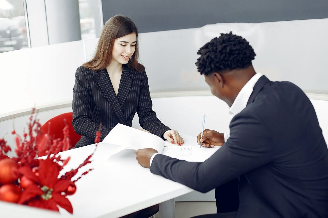 Real estate agents signing a contract.
