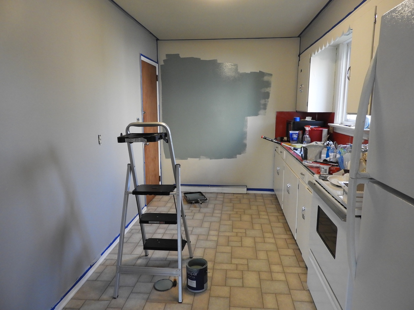 A back kitchen being repainted