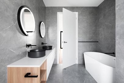 A minimalistic bathroom design with a dual-bowl vanity