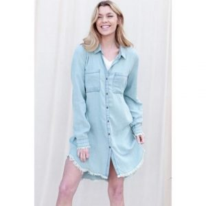 A model poses in a stunning denim dress-top that is perfect for summer.