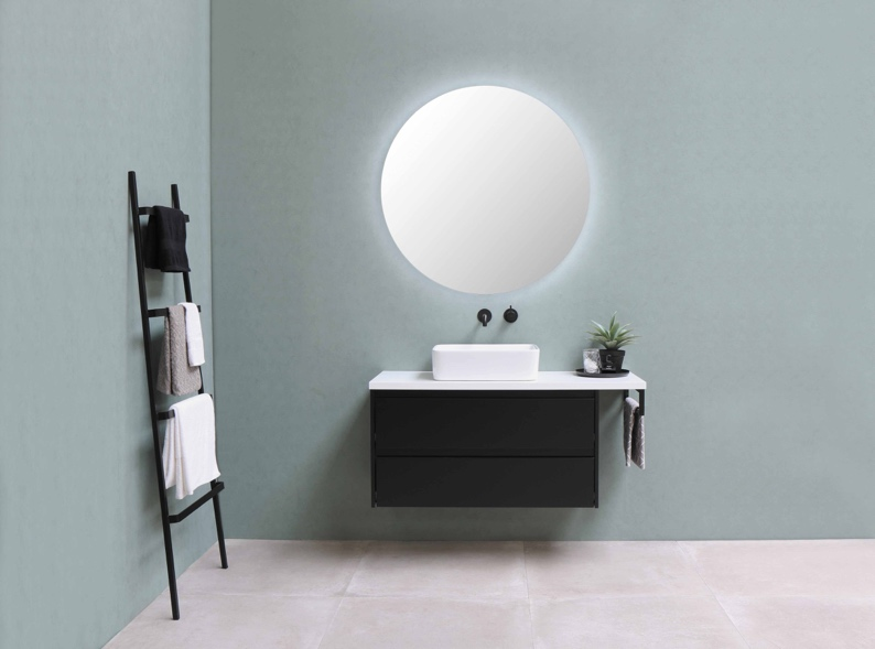 A small, floating vanity in a bathroom