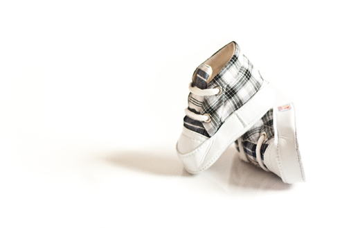 White and checkered baby shoes with laces