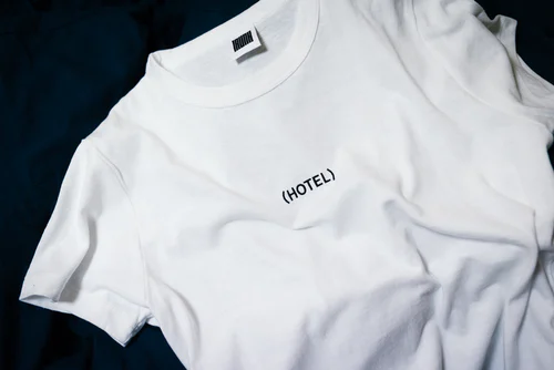 a plain white T-shirt with text