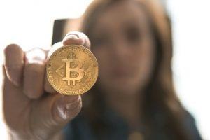 woman holding bitcoin.