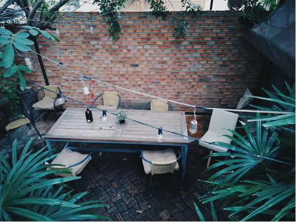 A deck with outdoor furniture.