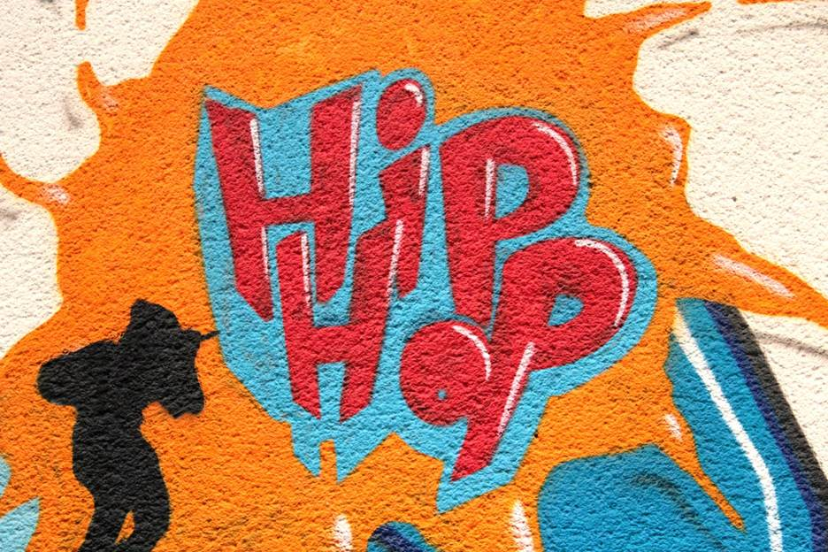 Orange, red and blue graffiti with a hip hop dancer
