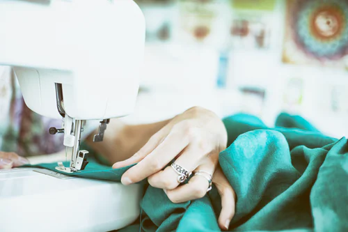 a person sewing clothes