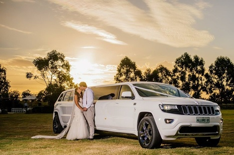 A wedding couple all set to make their wedding entrance in a limo