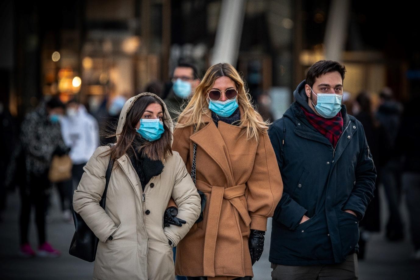 People outside wearing masks.