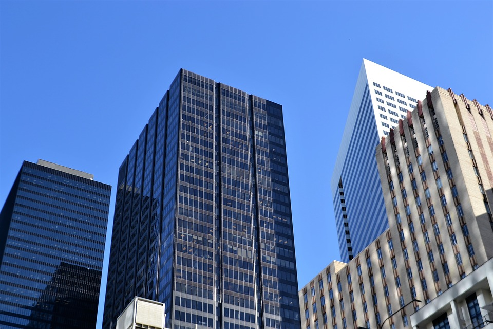 Residential buildings with black tinted windows.