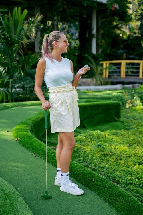 A happy female golfer