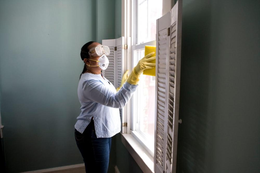 A woman cleaning her home's windows