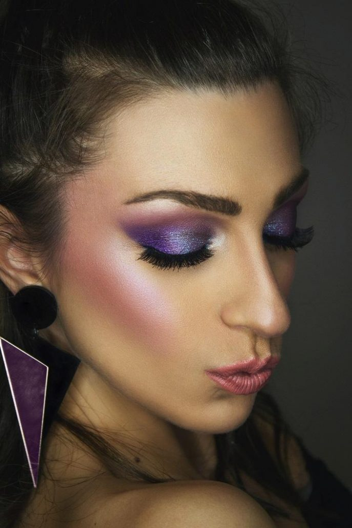 Purple goth makeup on a girl
