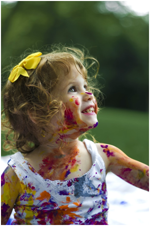 A girl enjoying foil painting.